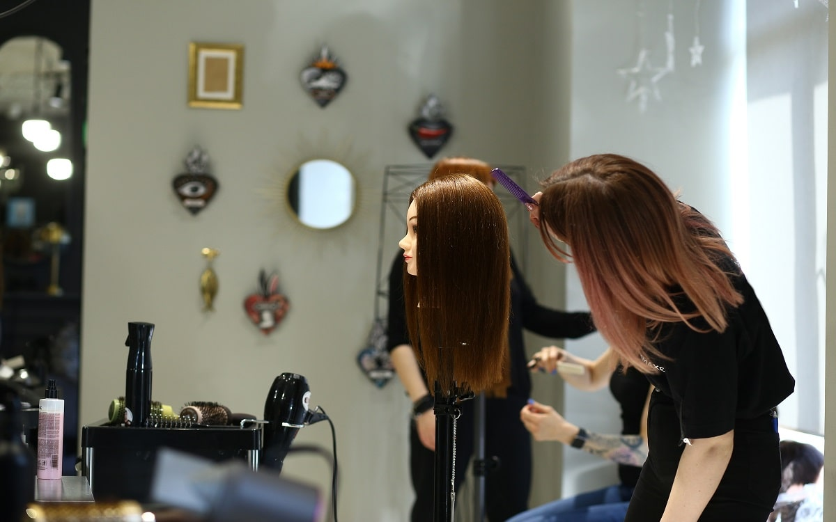 woman-practices-at-hair-salon